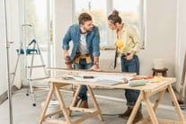 man woman with sawhorse