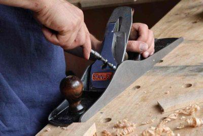Man fixing the wood tool