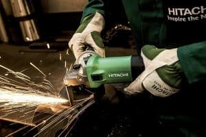Person using green Hitachi angle grinder