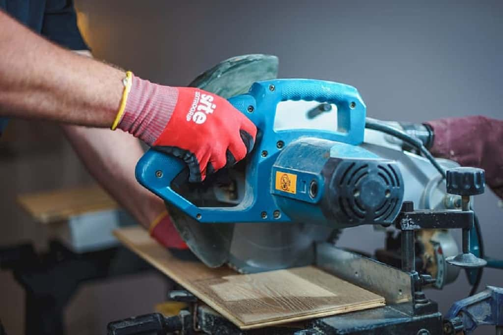 Person holding blue and red cordless power drill