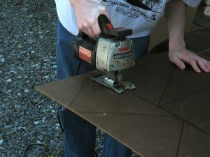 man using an old jigsaw