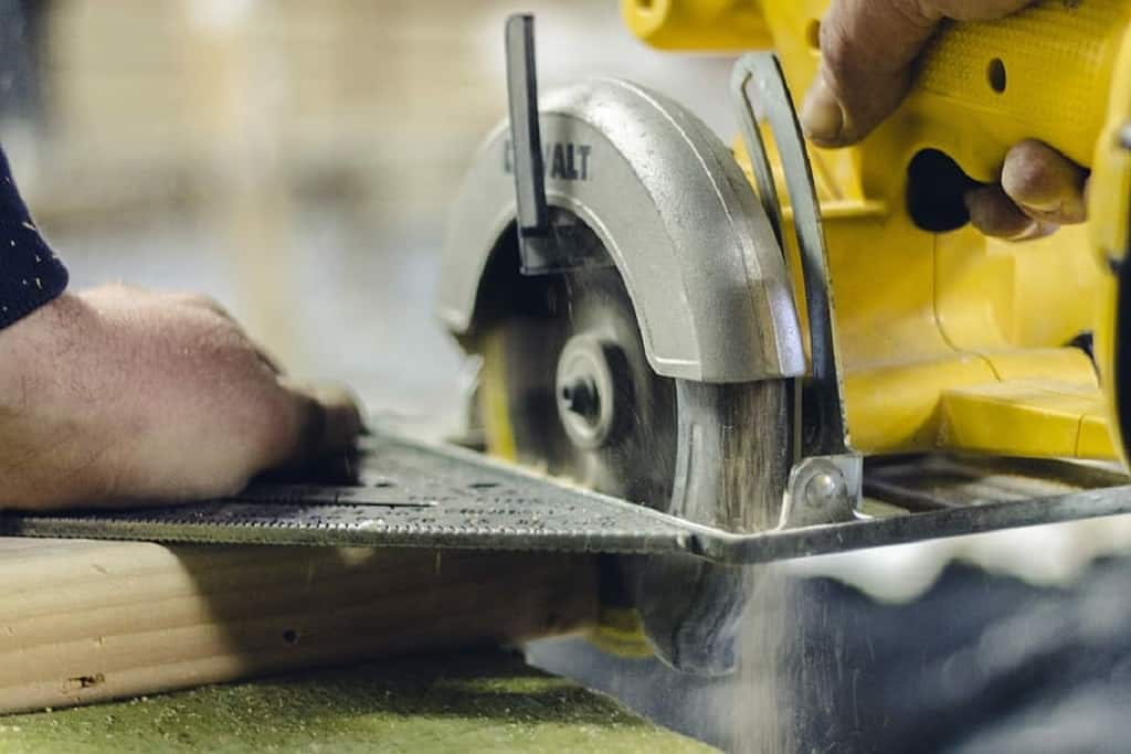 turned on circular saw person using DEWALT circular saw